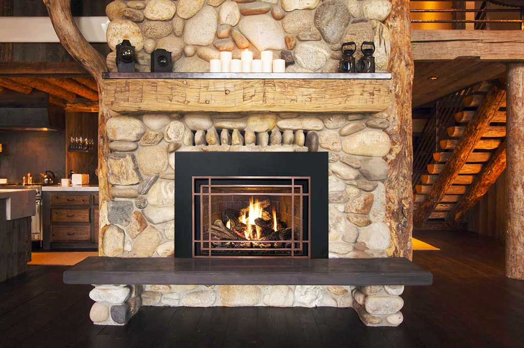 Stunning Design Of The Stone Fireplace Surround With Black Wooden Table In Front Of The Fire Place Areas