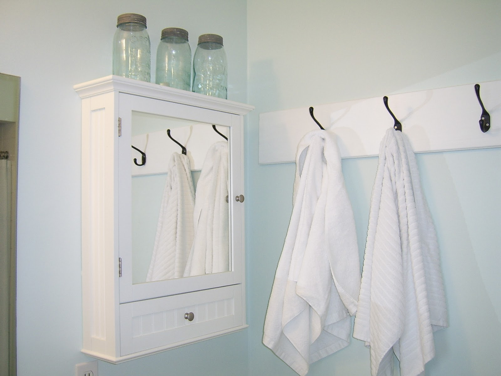 Stylish Bathroom With Storage and Mirror also Lush Towel Hooks