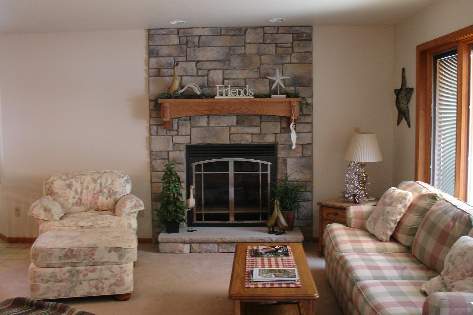 Stylish Family Room With Sofa also Wooden Table and Fireplace Stone Veneer