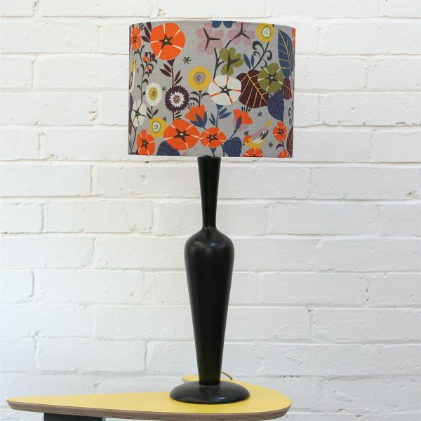 Stylish Table Lamp Design With Flowery Drum Shade and Dark Pipe