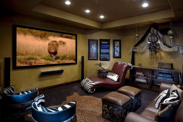 Sumptuous Movie Room With Large TV and Good Speaker Near Lounge Chair