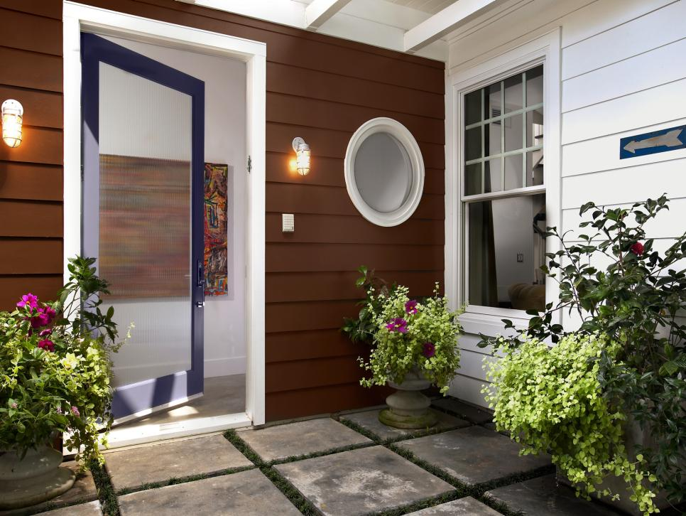 Superb Design Of The French Front Door With Brown Wooden Wall Added With Wall Mounted Lamp Ideas