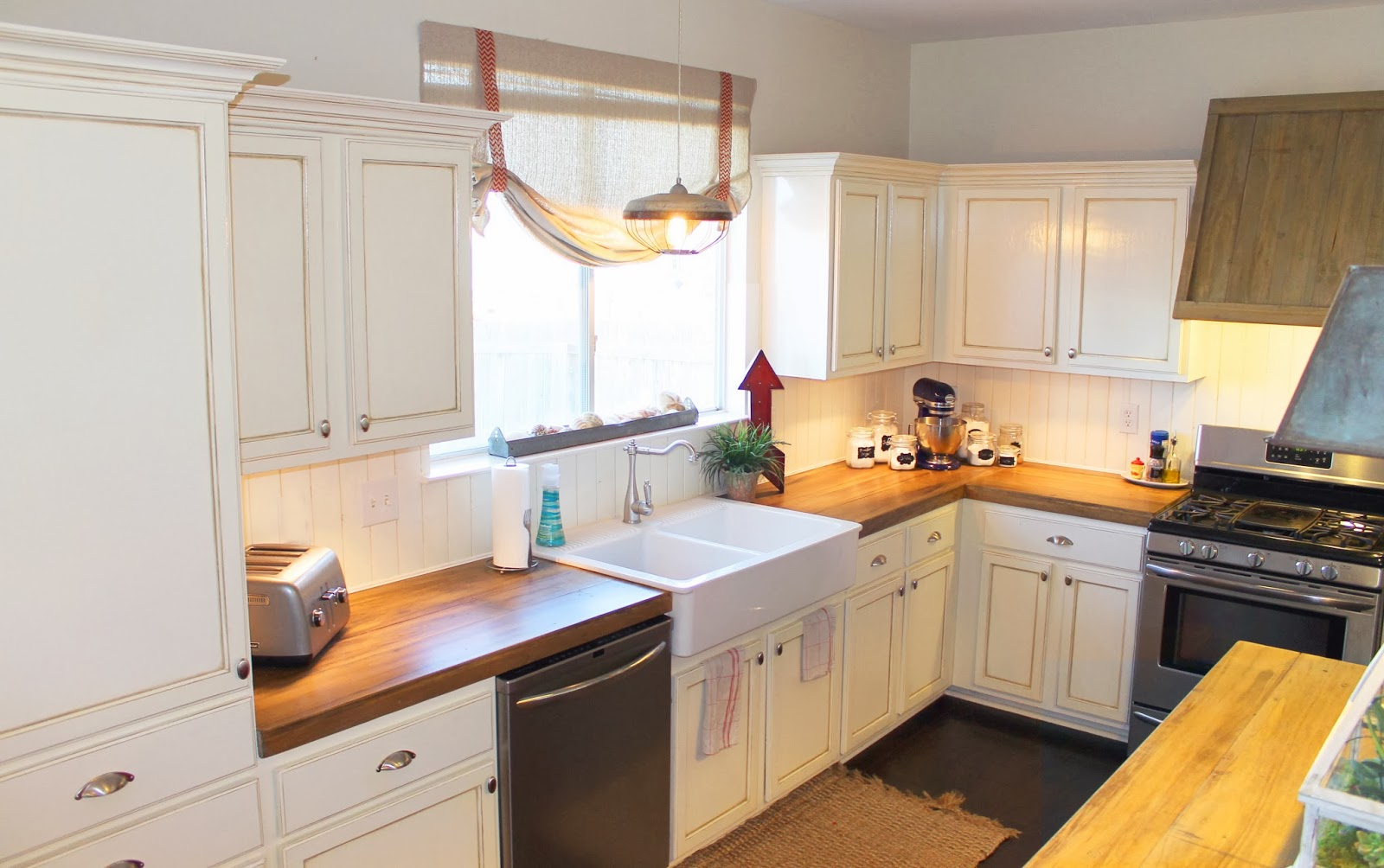 Superb Design Of The Kitchen Countertop Materials With White Cabinets Added With White Wall And Black Silver Stove Ideas