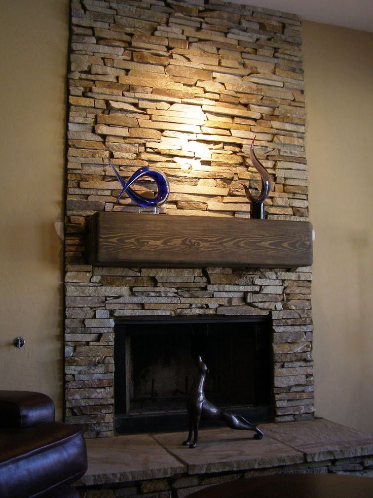 Superb Design Of The Stone Fireplace Surround With Reclaimed Wooden Shelf With Some Sculpture Decorations