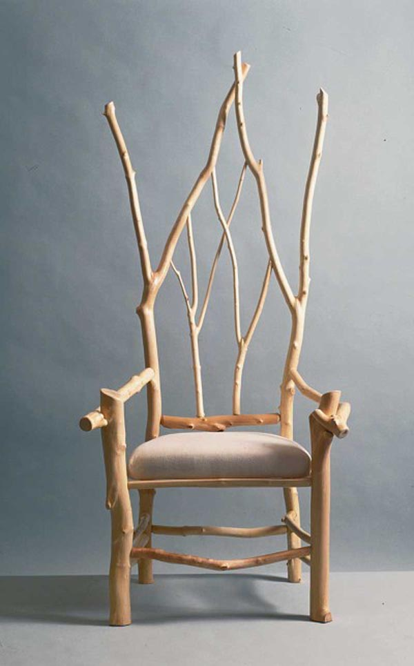 Unique Arm Chair Design Ideas Using Lush Back Tree Branch Decor