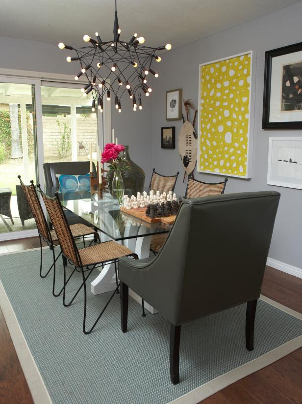 Beautiful Chandelier also Metal Top Dining Table plus lush Chairs