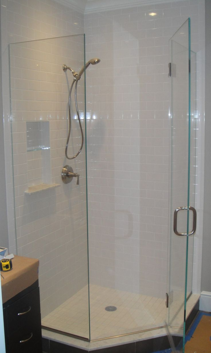 Beckoning Shower Area Design Using Visible Glass Door also Stainless Steel Knob