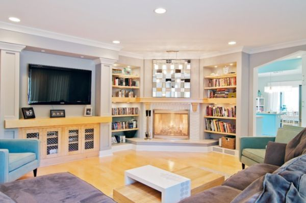 Captivating Family Room With Corner Fireplace Ideas Between High Book Shelve