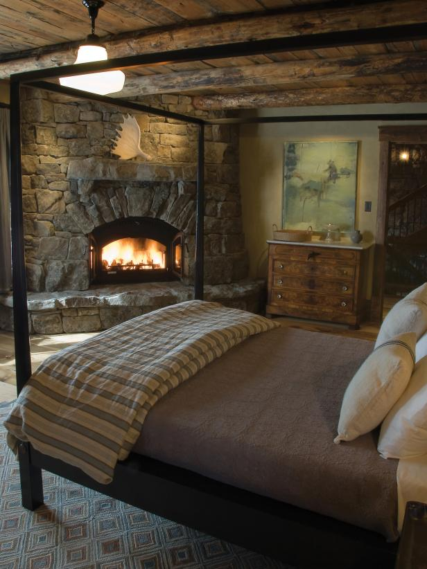 Classy Bedroom Design WithBed also Dresser Plus Corner Stack Stone Fireplace