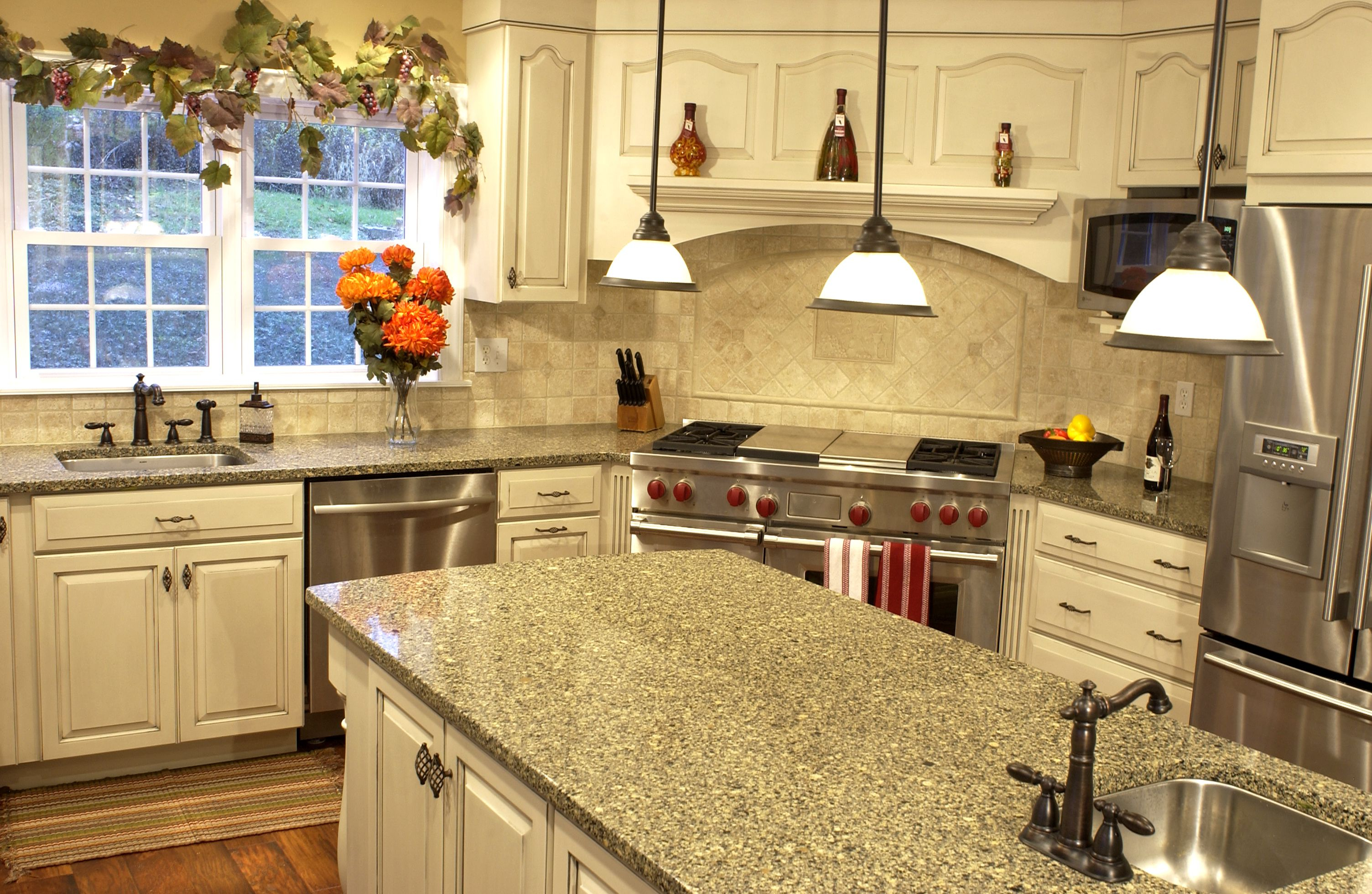Classy Interior Kitchen Using White Cabinet also Marble Top Plus Pendant Lighting