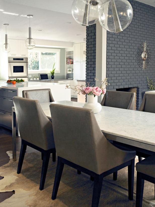 Dainty Chandeliers Above Rectangular Marble Dining Table Set and Chair