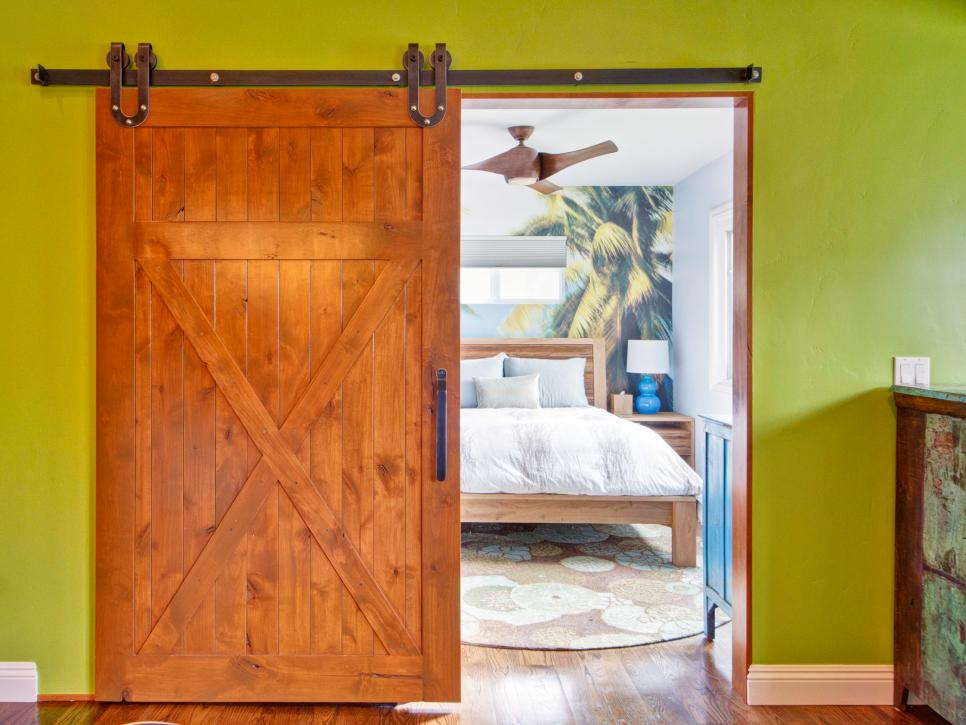 Delicate Style of Sliding Wooden Modern Barn Doors With Metal Pipe