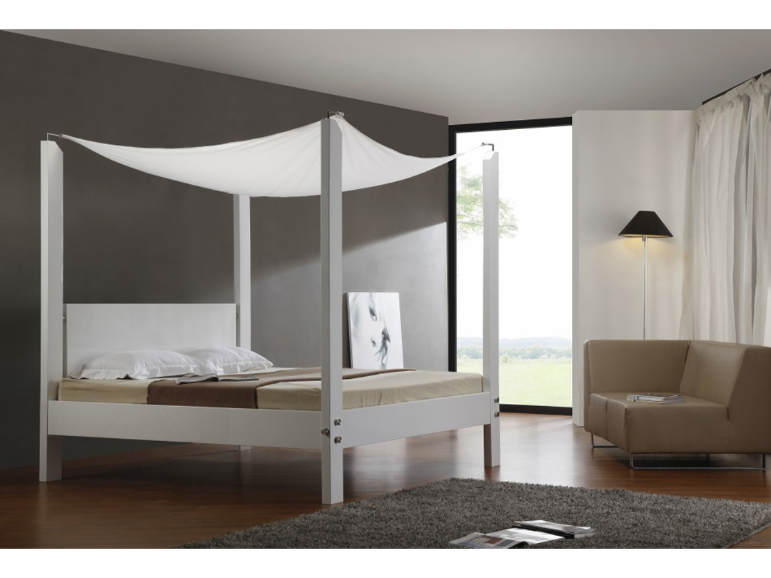 Entiching Bedroom Design With Lush Canopy Bed also Corner Sofa