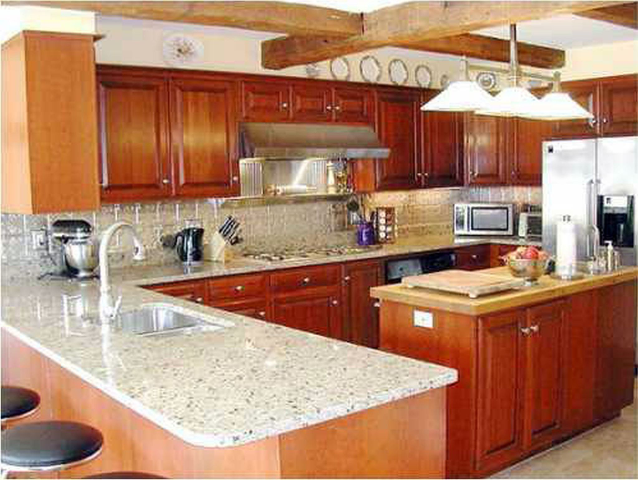 Fancy Interior Kitchen Counter Decor With Brown Wooden Cabinet Also Granite Top
