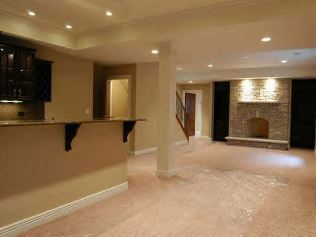 Impressive Basementt With Stone Fireplace Mantel also Mounted Shelve