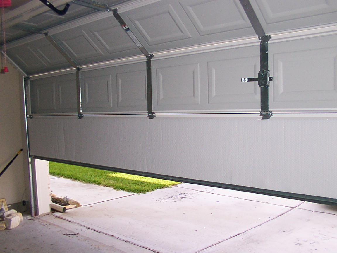 Radiant Garage Design Ideas Using White Folding Door With Key