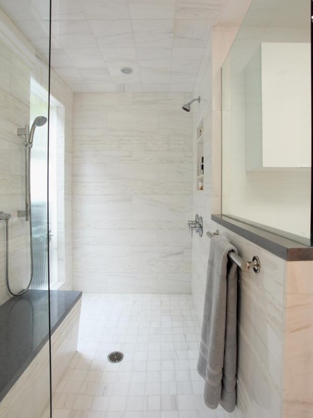 Radiant Shower Area Using White Wall and Ceiling Marble Tile also Mirror