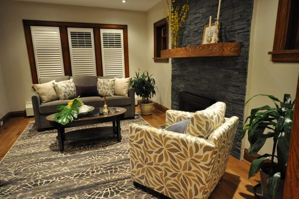 Small Living Room Using Gray Sofa and Arm Chair also Stack Stone Fireplace