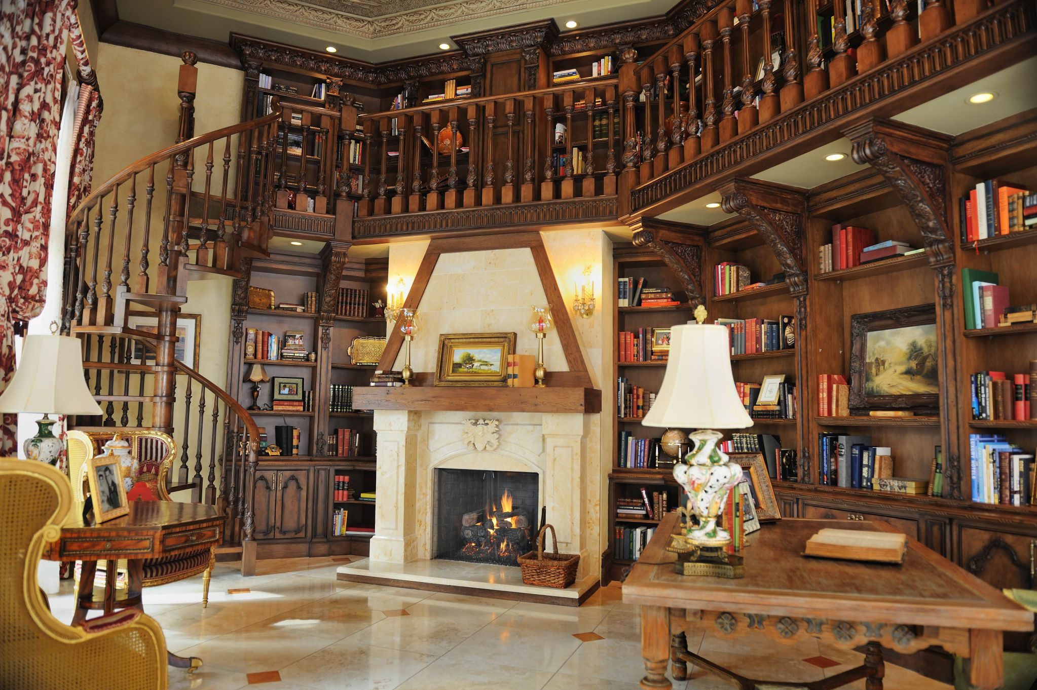 Wonderful Interior House With Fireplace between High Book Shelve Under Stairs