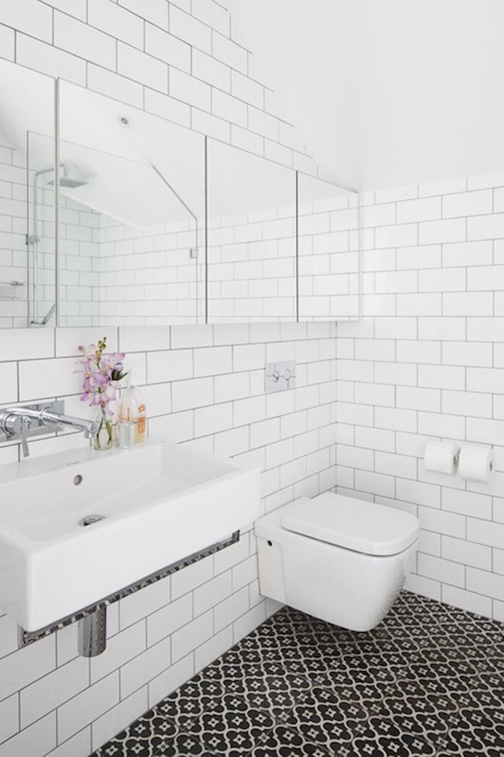 Captivating Interior Bathroom Using White Wall Tile also Sink and Toilet