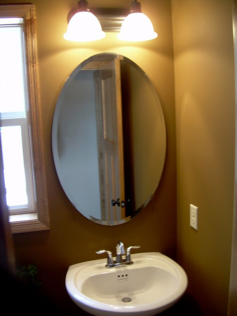 Delightful Interior Bathroom Using White Sink and Steel Faucet Plus Oval Mirror