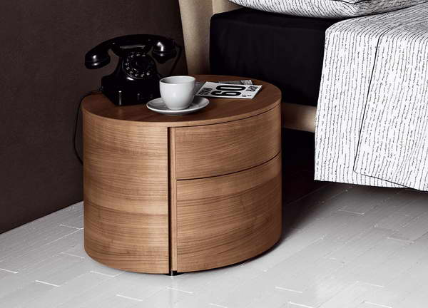 Fabulous Bedroom Design Using Round Wooden Side Table and Black Phone