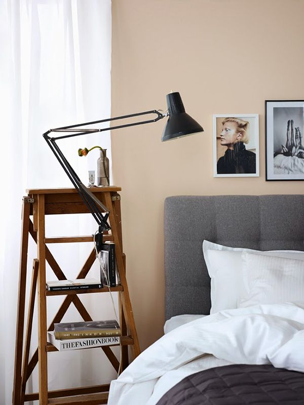 Lavish Bedroom Side Tables With Book Shelve and Black Arch Lamp