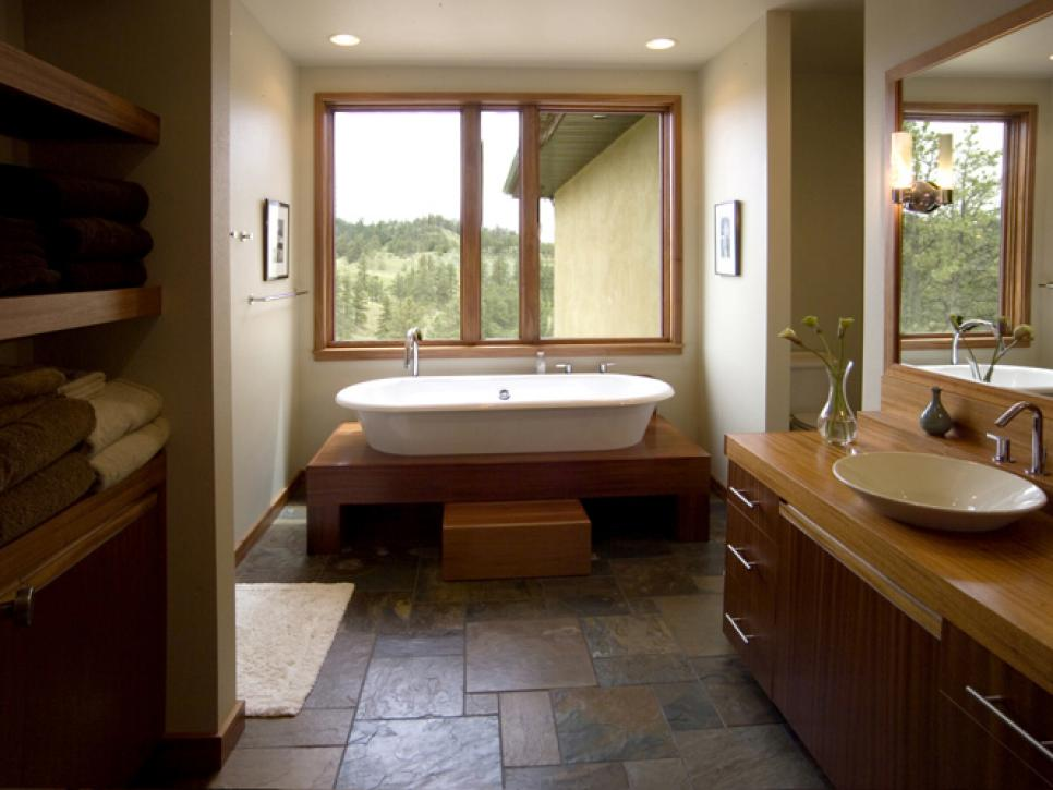 Provocative Bathtub Witth Wooden Cabinet also Mirror Plus Marble Ceramic Tile