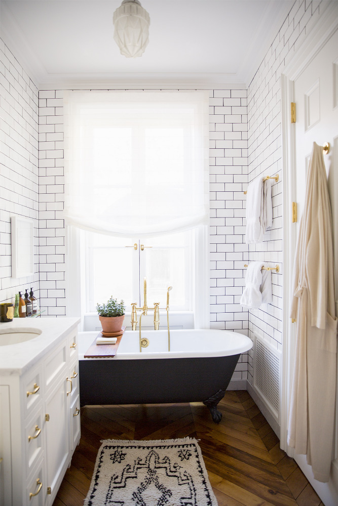 Small Bathroom Theme Ideas With Bathtub Beside Cabinet also Chandelier