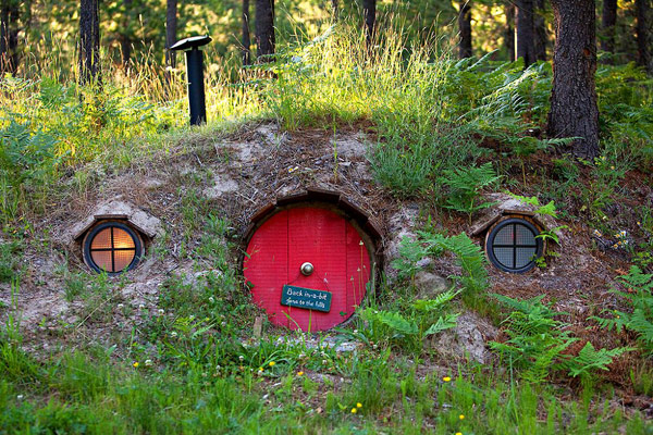 Stunning Hobbit House Design With Natural Exterior also Circle Windows