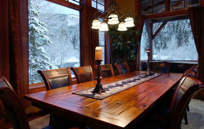 Captivating Wooden Table and Chairs Under Chandelier For Decorating Dining Table