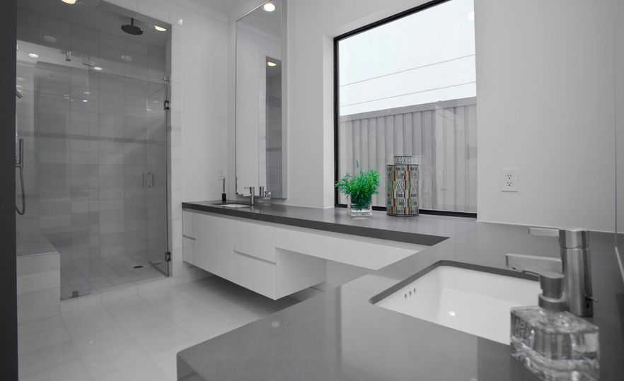Contemporary Interior Gray And White Bathroom With L Shape Cabinet Using Luring Top