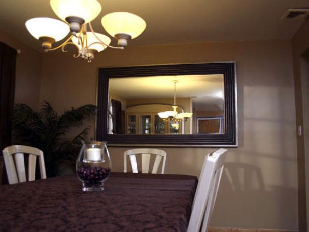 Horrible Interior Dining Space Using Mirror On Wall also Chandelier Above Table