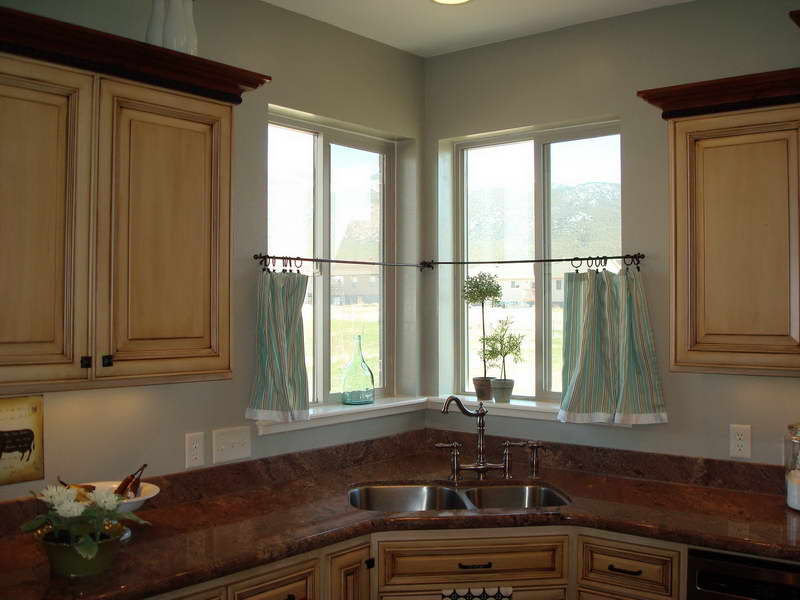 Ideal Kitchen Design With Corner Stainless Steel Sink and Faucet also Curtain