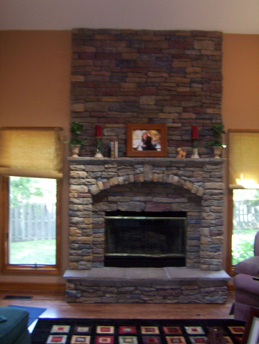 Impressive Living Room Using Stone Fireplace Ideas With Shelve Between Windows