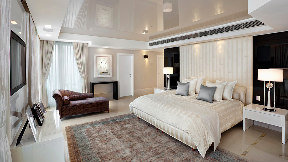 Luxurious Bedroom With Bed also Table Lamps On Desk Plus Brown Sofa
