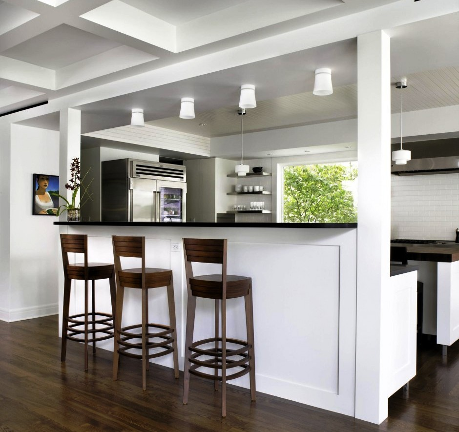 Modern Interior Kitchen With Lush Bar Table and Chair under Lamps