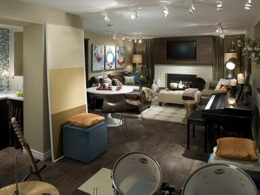 Stylish Interior Basement With Sofa also Table and Track Light Fixture