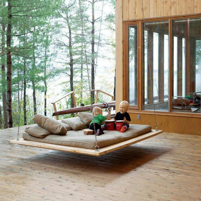 Sumptuous Deck Using Lavish Bed Swing With Matress and Pillows