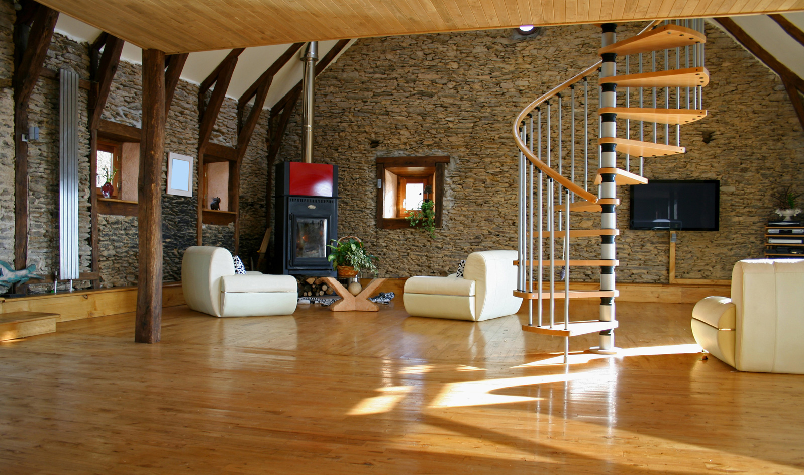 Amazing Family Room With Wood Flooring Ideas also White Sofa and Corner Fireplace