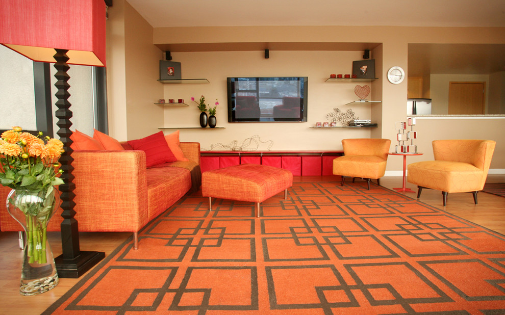 Delicate Living Area Design With Orange Sofa And Chair also Coffee Table