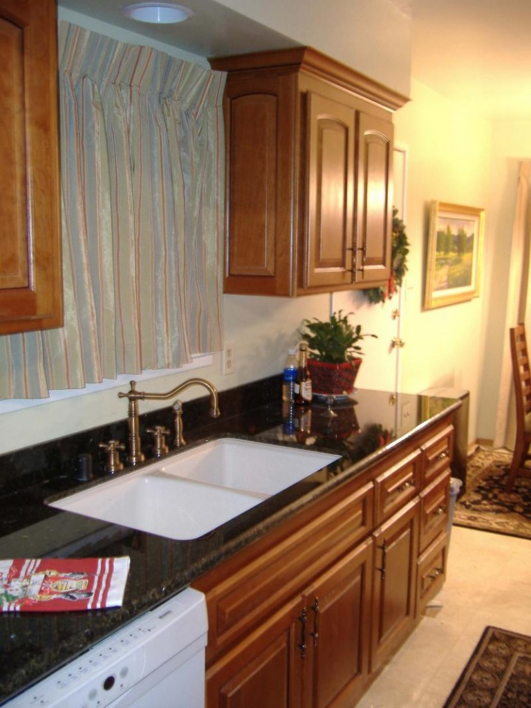 Fetching Wooden Cabinet With Black Countertop For Decorating Kitchen Islands