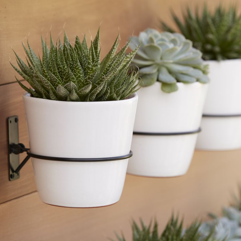 Interesting Style Of White Indoor Flower Pots Using Stainless Steel Pipe