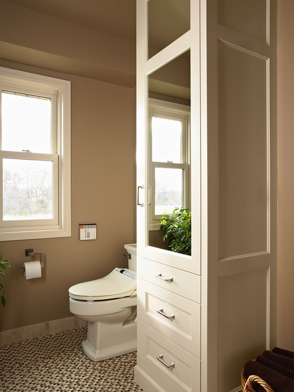 Lovely Bathroom Cabinet Storage With Mirror Beside Toilet and Basket