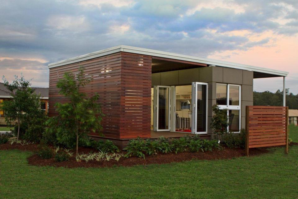 Nice Exterior Prefab House Design Using Wooden Wall Panelling and Visible Windows