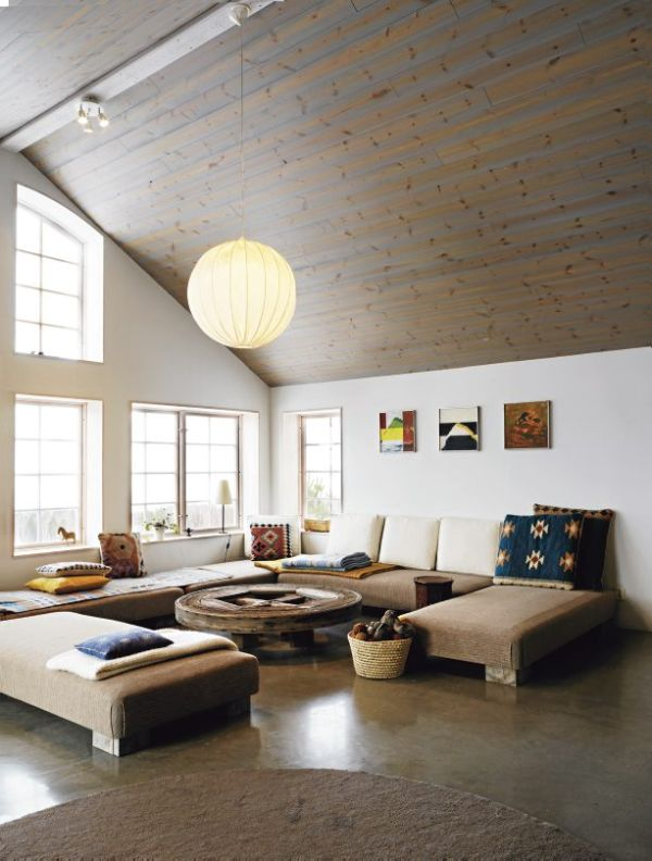 Pleasant Living Room Using Modern Sectional Sofa also Rustic Circle Coffee Table