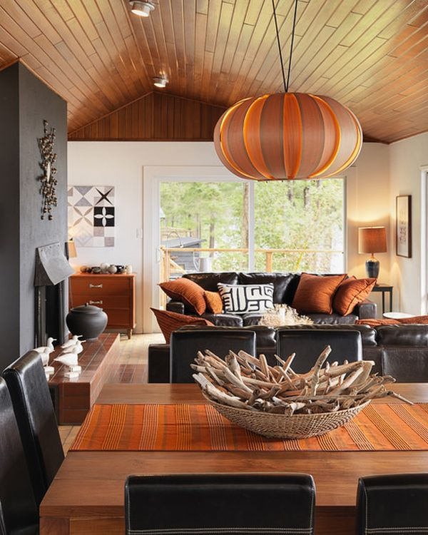 Radiant Interior Living Space Using Leather Black Sofa and Orange Pillows