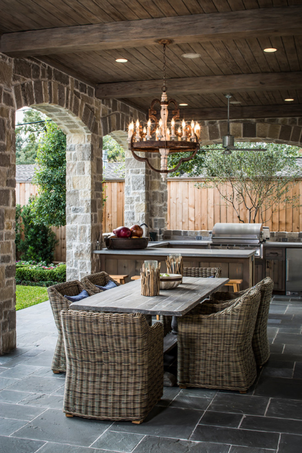 Stylish Outdoor Dining Room With Wicker Chairs and Wooden Table