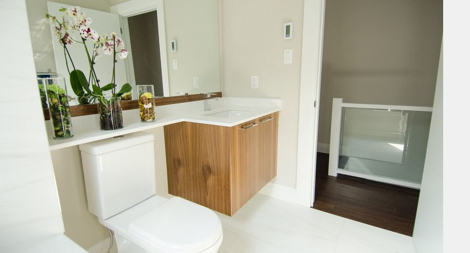 Beautiful Tantalizing Bathroom Design With Hanging Cabinet Also Mirror And Toilet