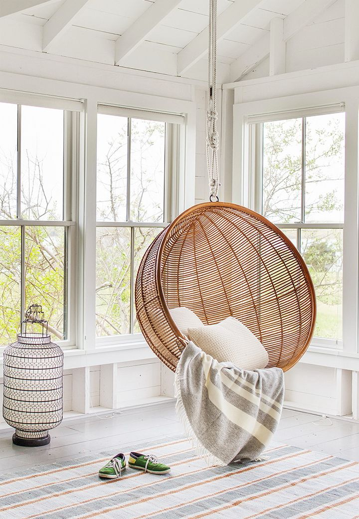 Wonderful Room Design Using Brown Swing Chair With Two Pillows
